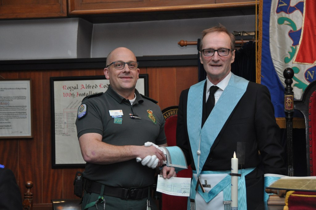 Worshipful Master Iain Campbell,presents a cheque for £750 to Simon Parry of Mansfield Community First Responders