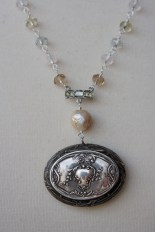 Necklace made with antique powder compact and pearls
