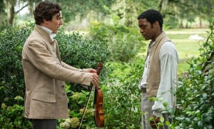 Benedict Cumberbatch, left, and Chiwetel Ejiofor in a scene from the film 12 Years a Slave