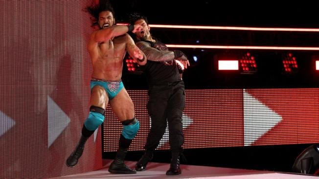 Roman Reigns slaps Jinder Mahal on the RAW stage