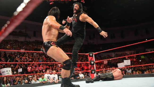 Roman Reigns Superman punches Drew McIntyre