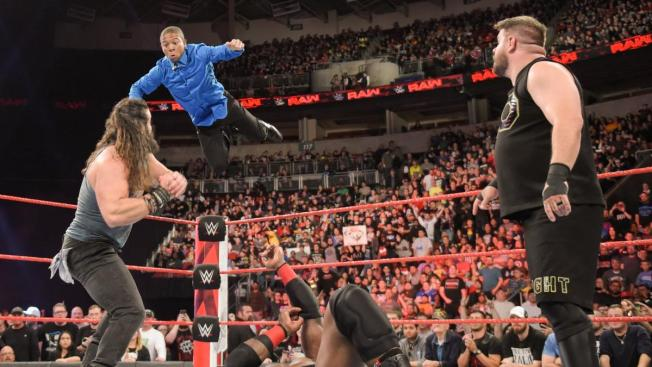 Elias prepares to swat Lio Rush out of the air. Owens looks on.
