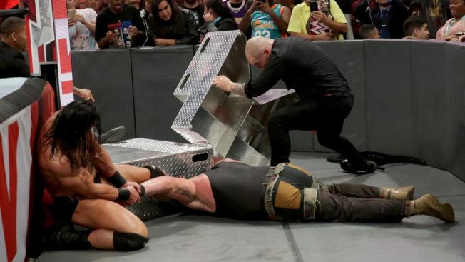 Braun Strowman is attacked by Drew McIntyre and Baron Corbin