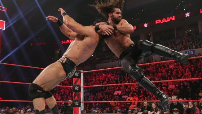 Seth Rollins with a slingblade to Drew McIntyre
