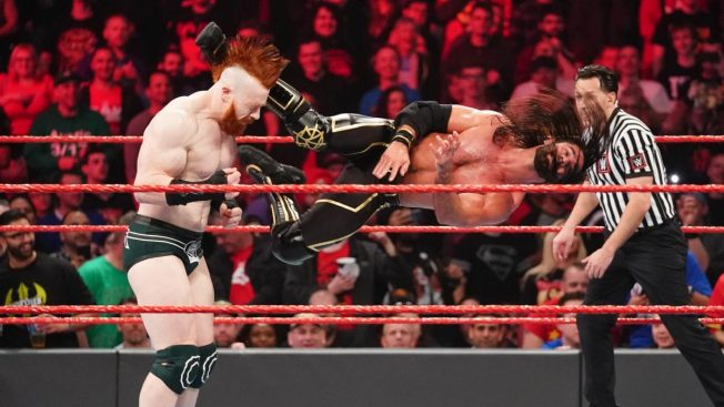 Seth Rollins dropkicks Sheamus