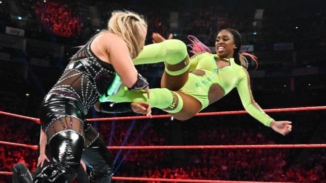 Naomi dropkicks Natalya