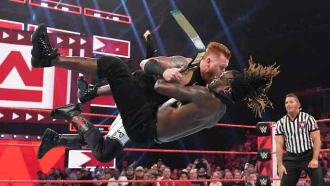 Heath Slater and R-Truth battle for the 24/7 championship