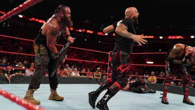 Braun Strowman hits Karl Anderson with a chair