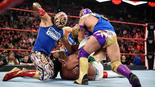 Lucha House Party beat up Andrade