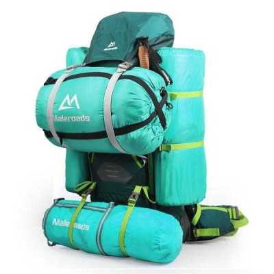 Tramping pack with gear strapped to outside