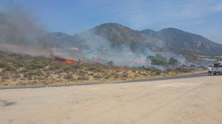 Firefighters are currently battling a brush fire in the Cajon Pass. (Photo by Garrett Schual‎)