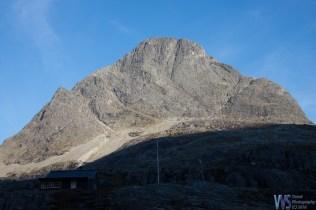 A massive mountain towers above the Trollstigen mountain road.