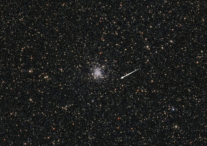 This spectacular starry field of view shows the globular cluster NGC 6553 which is located approximately 19 000 light-years away in the constellation of Sagittarius. In this field, astronomers discovered a mysterious microlensing event. Microlensing is a form of gravitational lensing in which the light from a background source is bent by the gravitational field of a foreground object, creating an amplified image of the background object. The object causing the microlensing in NGC 6553 bent the light of a red giant star in the background (marked with an arrow). If this object lies in the cluster — something the scientists believe might only have a 50/50 chance of being correct — the object could be a black hole with a mass twice that of the Sun, making it the first of its kind to be discovered in a globular cluster. It would also be the oldest known stellar-mass black hole ever discovered. However, further observations are needed to determine the true nature of this lensing object for sure. This cosmological curiosity was detected by ESO's VISTA telescope at the Paranal Observatory in Chile as part of the VISTA Variables in the Vıa Lactea Survey (VVV) — a near-infrared survey aimed at scanning the central parts of the Milky Way. Link: Science Paper by Minniti et al (2015) VVV Survey