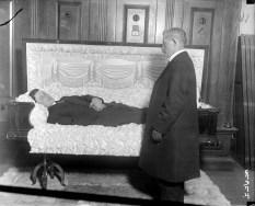 Casket Tester Lying in Coffin