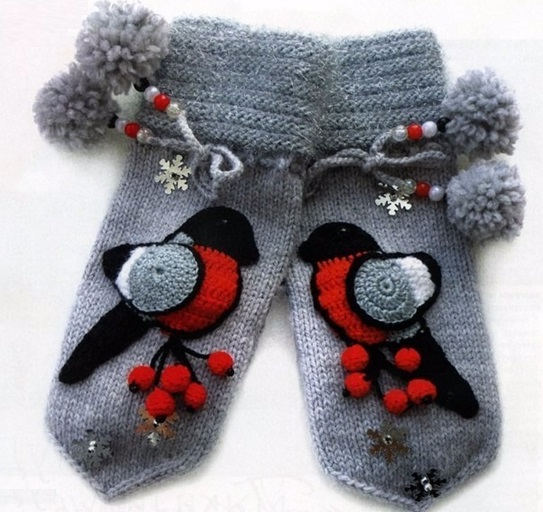 Beautiful mittens for children with bullfiner and pompons