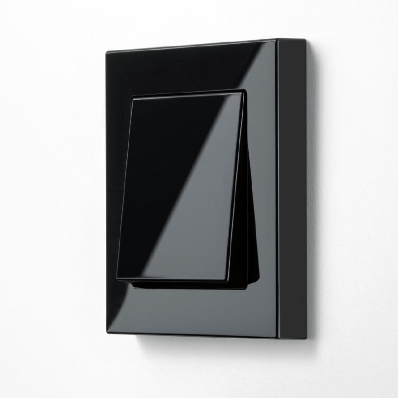 Vypínač JUNG A 550 lesklá černá