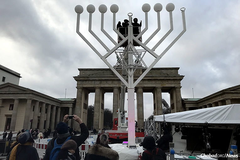 A menorah organized by Chabad-Lubavitch of Berlin stands at the Brandenburg Gate in Berlin, Germany, on Tuesday, Dec. 12, the first night of the eight-day holiday of Chanukah.