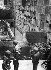 Israeli forces looking at the Western Wall just before it was secured by the IDF.Photo: Israel National Photo Archive