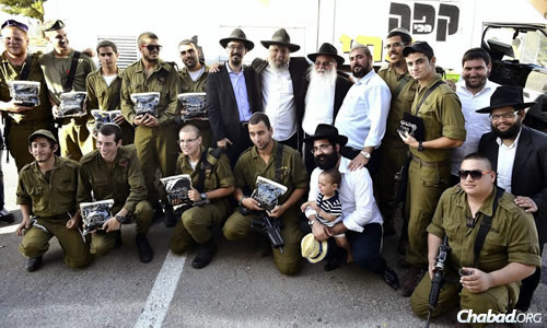 Ten soldiers from the Israeli Defense Forces recently received their own sets of tefillin. Rabbi Moshe Gourarie, co-director of Chabad of Toms River, N.J., was in Israel at the time and met the young men.
