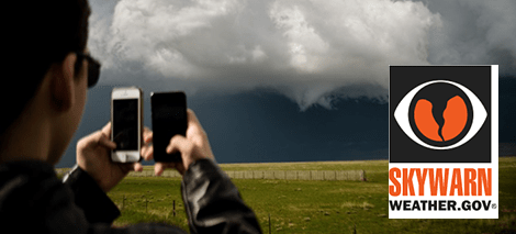 Storm spotter capturing image of developing tornado with cell phones
