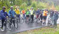 The group gathers despite the rain