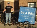 "Sign says ""Be a Pal"" on bike Trailer"