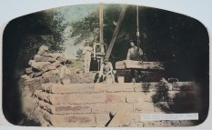 In this 1904 photograph, A.E. Forinash, Clyde Forinash, Frank Weber, and Charlie Funk are seen constructing a bridge over Antelope Creek, north of Alma. This crew constructed over 70 bridges for Wabaunsee County.