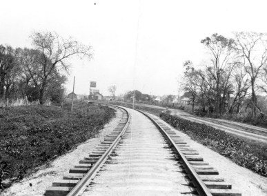 This view of the ATSF tracks was taken by long-time Eskridge businessman, Dean Dunn. In the distance to the west one can see the Eskridge Coop, located along the tracks. Beyond that one can see the Eskridge depot.