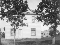 James and Dorthea Barger built this new home in the 1000 block of Ohio Street in Alma, Kansas in 1909. The Bargers purchased the lot for the house when they bought the Alma Bottling Works, visible in the background.