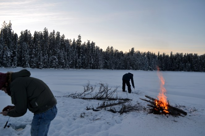 A fire to keep warm while ice fishing in -30 in the Yukon