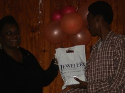 Shem Alexander collecting his prize as the main art winner in the 2010 Wadadli Pen Challenge from the Museum's Michelle Henry.