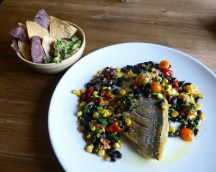 Fillet of bream with black bean, corn, roasted red pepper, salsa, guacamole & tortillas