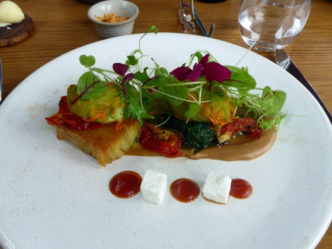 Broad bean filled courgette flower with nettle pesto, tomato & feta