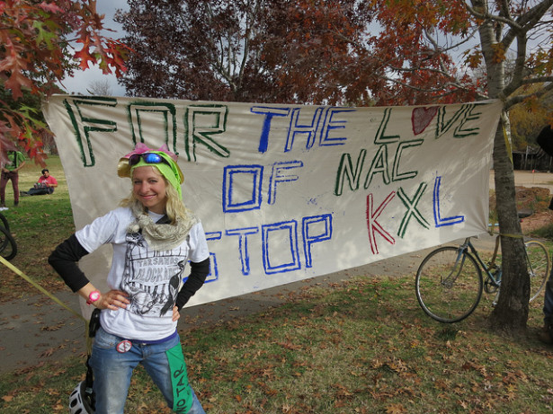 A Tar Sands Blockade activist shows off her banner in Nacogdoches, Texas. (Flickr / Tar Sands Blockade)