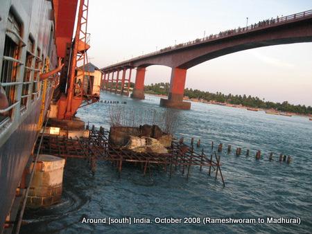 a train passes from over a sea bridge leaving rameswaram behind
