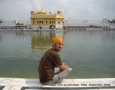 Using tripod and self-timer, I take my own photo with the Golden Temple at the background.