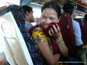 smiling woman inside the bus