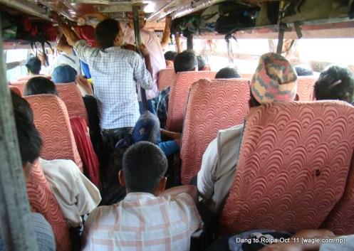 in the bus to rolpa. the bus crawled on the road.
