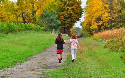 Katie and Deb walking in the fall