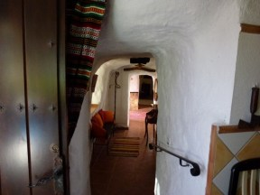 Hall across front of cave (the only windows)from Kitchen, thru sitting, entry and living room on other side.