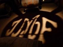 José Maria da Fonseca Moscatel Cellar - Chandelier Monogram projected on floor