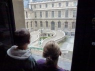 The kids admiring the courtyard at the Louvre
