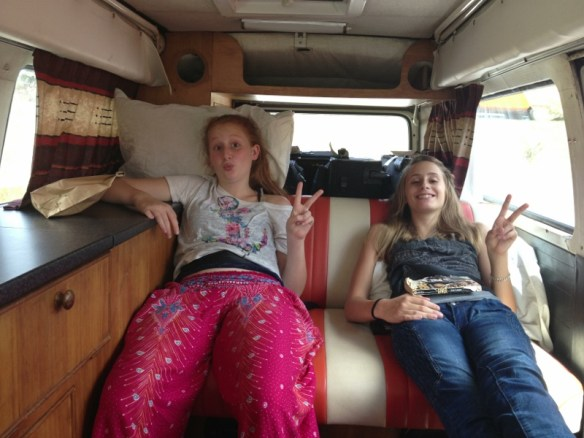 Calla and Magno in the back of the campervan in New Zealand.