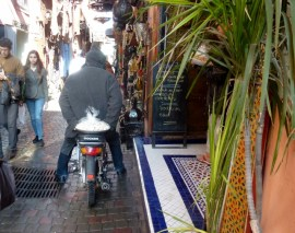 A scooter delivering cookies in the Marrakech Medina