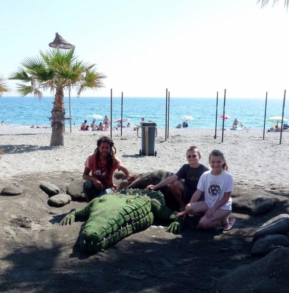Sand Scultped Crocodile on San Cristobal Beach Almunecar Spain with artist Pepe