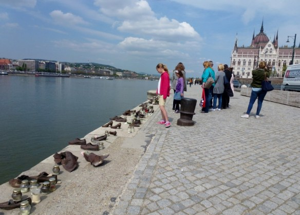 Budapest Hungary - Anya viewing the Shoes on the Danube Promenade