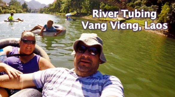 River Tubing in Vang Vieng Laos isn't just for the twenty somethings! It isn't all backpackers and parties, it can be family friendly too.  We had three generations out tubing and enjoying the day in Vang Vieng.  Read more on WagonersAbroad.com