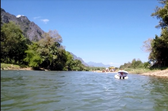 Gma Bev tubing in Laos. River Tubing in Vang Vieng Laos isn't just for the twenty somethings! It isn't all backpackers and parties, it can be family friendly too.  We had three generations out tubing and enjoying the day in Vang Vieng.  Read more on WagonersAbroad.com