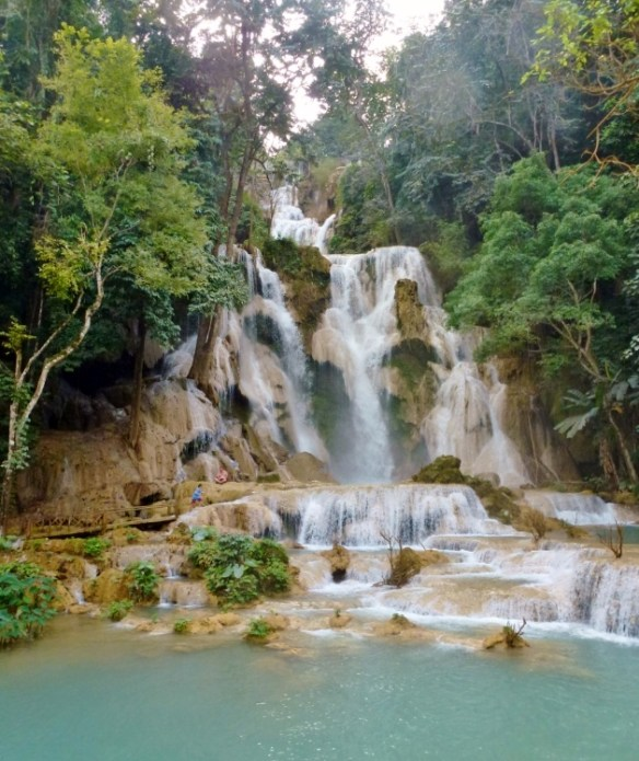 Swim in the stunning Kuang Si Waterfalls in Luang Prabang Laos.  Enjoy the spectacular blue colors of the large multi-stage Kuang Si Waterfall and pools, accessible by boat or truck hire, some 29km south of Luang Prabang. Read more on WagonersAbroad.com