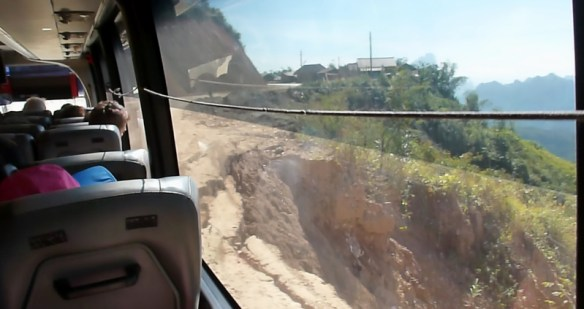 VIP Bus Laos the edge of a landslide